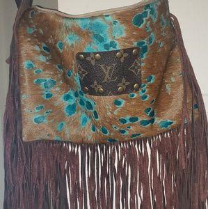 LV fringe purse